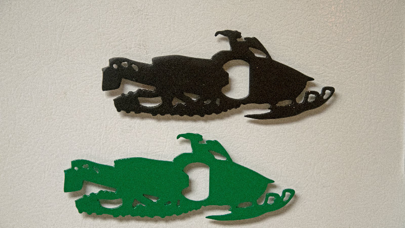 Snowmobile magnet bottle openers