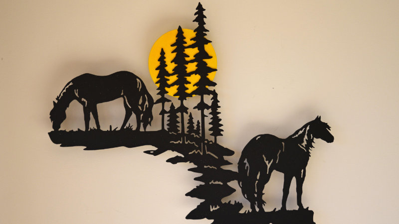 Horses grazing by moonlight