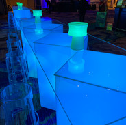 Color changing Geo tables with barstools and color chaning mini cylindrical lamplites
