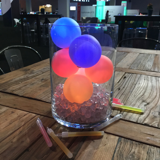 Glow Balls immersed in a glass vase