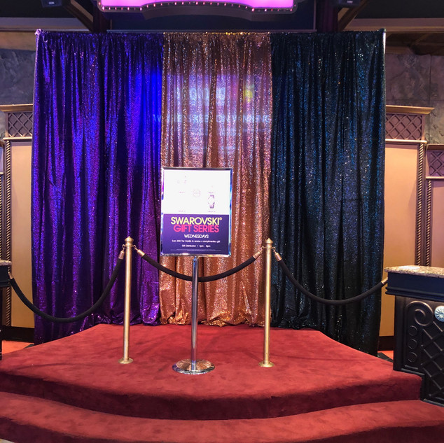 Purple, gold, and black sequined curtain