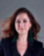 Marie%20Full%20headshot%20(grey%20backgr