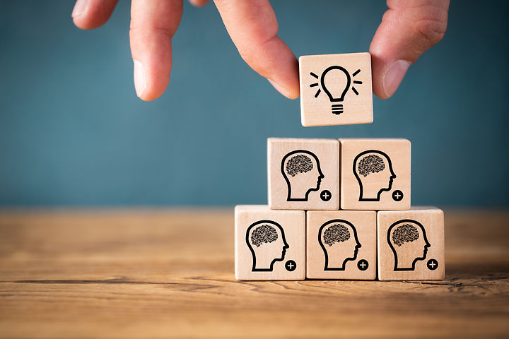 many people together having an idea symb
