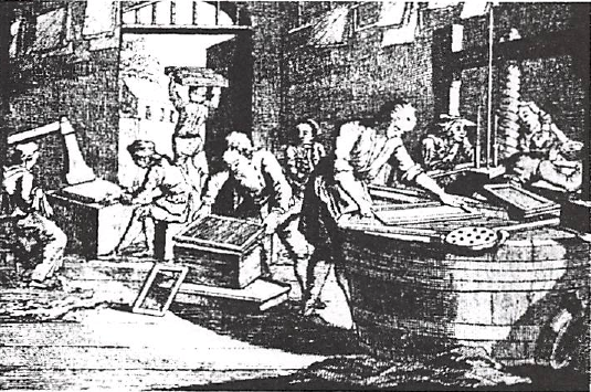 """French paper mill showing the large wooden screw press for squeezing the water out of the newly made sheets, the """"spurs"""" of paper being hung to dry and the large stone hammers (left) to polish each set"""