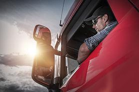 Red Semi Truck. Caucasian Truck Driver P