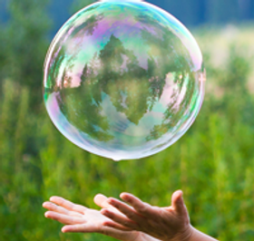 2012-hand-catching-a-soap-bubble-crop.pn
