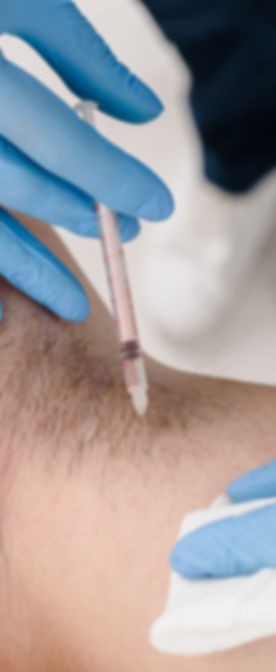 Closeup of female doctor making injectio