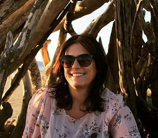 TS smiling in hut on beach.jpg