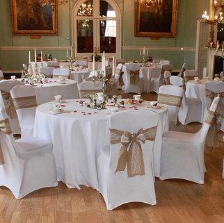 Vintage Wedding Venue Kings Lynn Town Hall Vintage Afternoon Tea China displayed on White Tablecloths