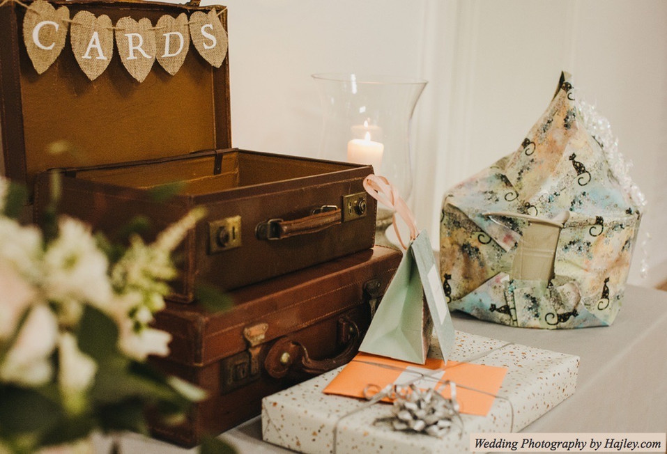 Vintage Suitcase to Collect Cards Displayed on Wedding Gift Table at Holkham Hall Norfolk