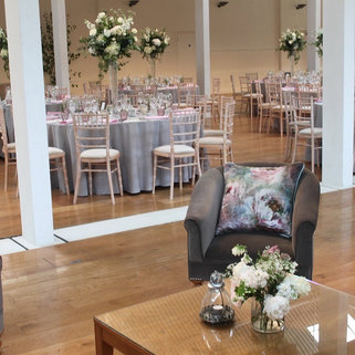 Grey Velvet Chair with beautiful Voyage Cushion, Wedding Prop Hire and Event Dressing