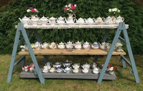Vintage Teapots Displayed on Rustic Trestles and Shelves. Available to Hire North Norfolk.