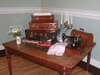 Vintage Suitcase Stack with Candelabra and Vintage Sewing Machine Wedding Venue Styling