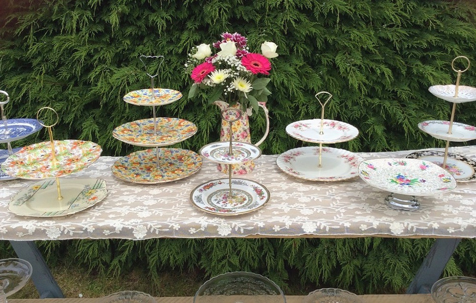 Tiered Vintage Cake Stands displayed on Rustic Shelves Prop Hire For Tea Parties