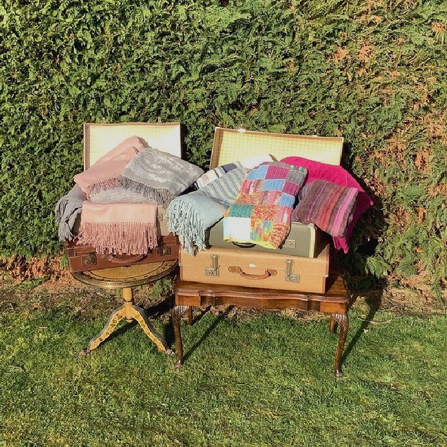 Vintage Suitcases with Blankets and Throws Hire for Wedding and Events