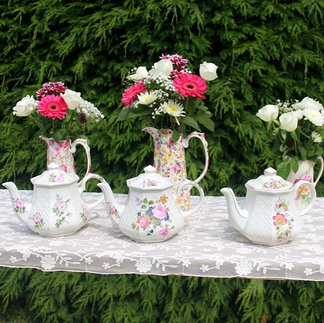 A Trio of Floral Vintage Teapots iwth Flower Display