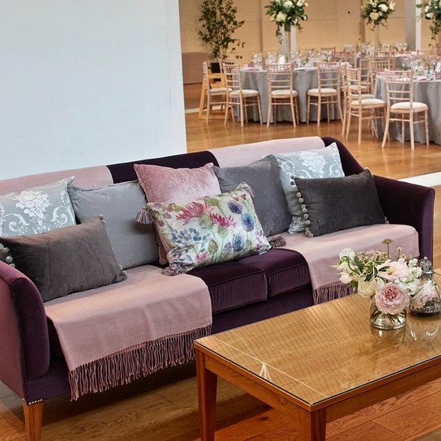 Holkham Hall Venue Sofas Dressed with Pink and Grey Throws and Cushions to Compliment Wedding Colour Theme