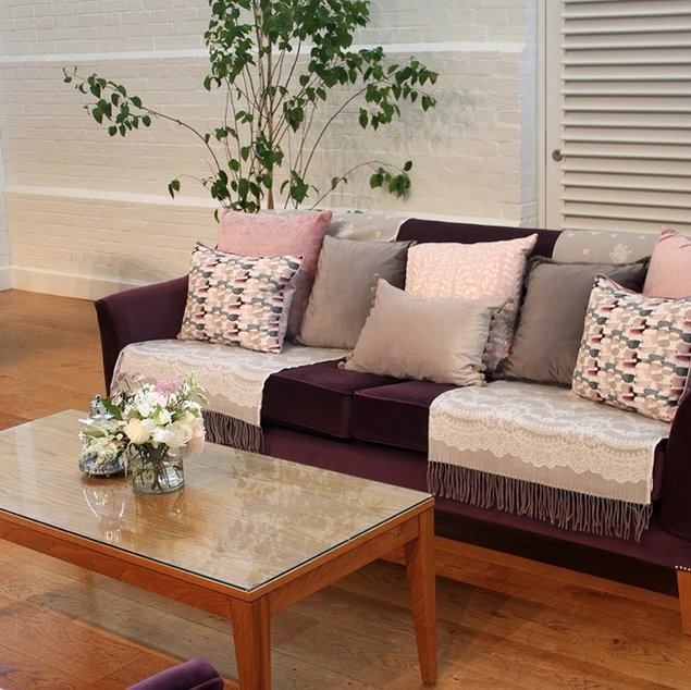 Event Venue Dressing Pastel Pink and Grey Cushions and Throws on Purple Sofa