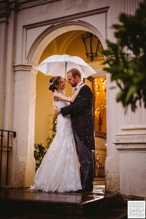 Bride and Groom with Ivory Wedding Umbrella