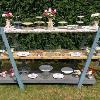 Vintage Cake Plates Displayed on Vintage Trestles Tea Party Hire