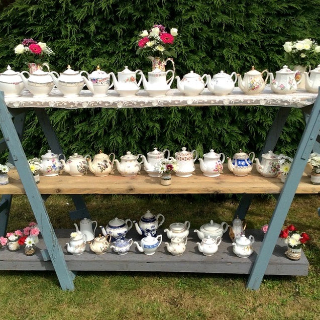 Vintage Teapots Displayed On Rustic Trestles and Shelves Vintage China Hire