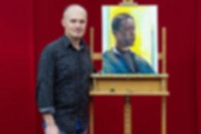 Emil Nikolla with portrait of Adrian Les