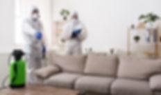 Men in virus protective suit making trea