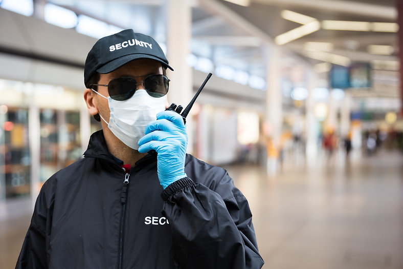 Security Guard Standing In Face Mask In