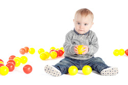 Baby Boy Playing With Balls