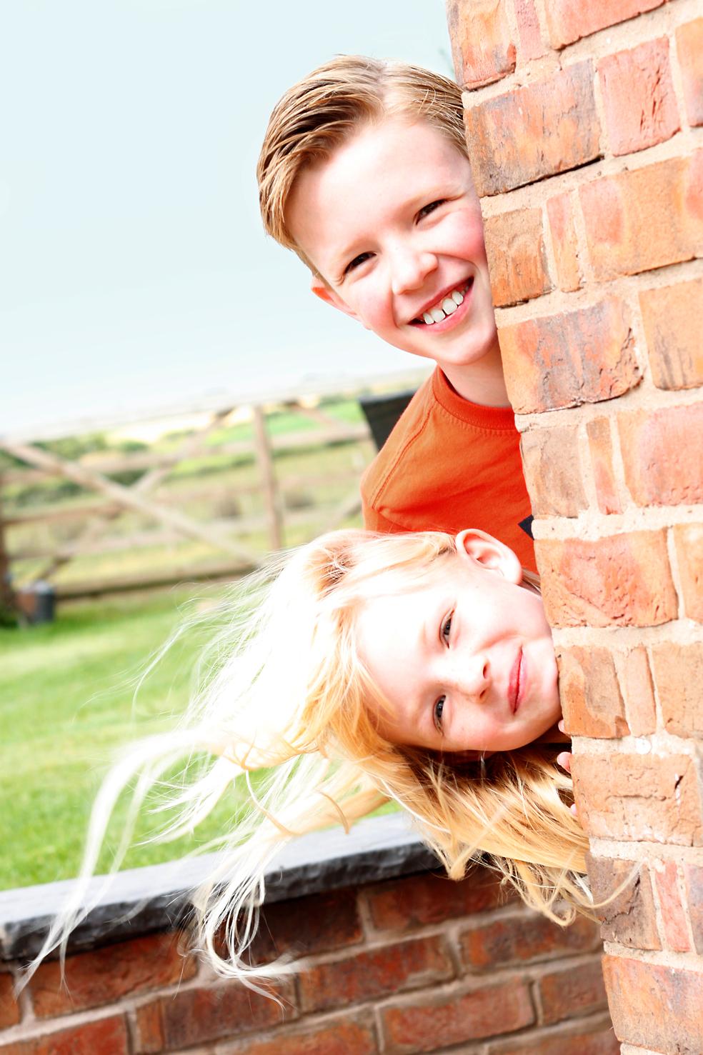 Children looking around Corner