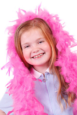 Child In Feather Boa