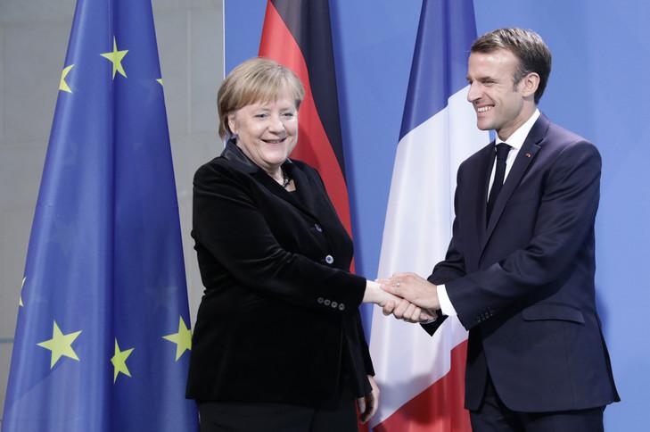 Angela Merkel et Emmanuel Macron, le 18 novembre à Berlin. / Kay Nietfeld/dpa/picture-alliance