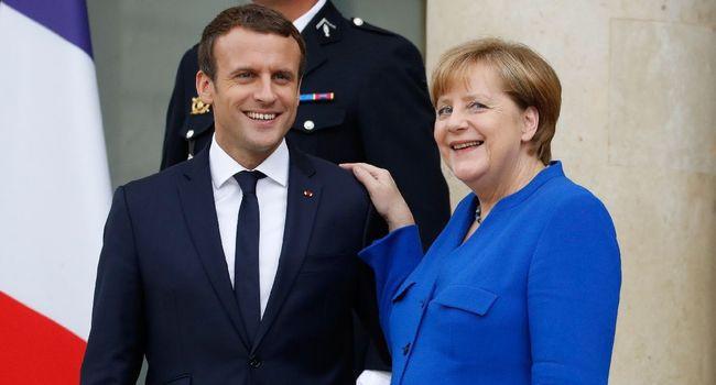 Le président français Emmanuel Macron et la chancelière allemande Angela Merkel à l'Elysée le 13 juillet 2017 à Paris Patrick KOVARIK  /  AFP