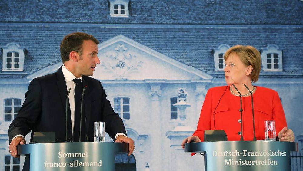 Emmanuel Macron et Angela Merkel durant leur conférence de presse mardi sur la réforme de l'Union européenne | LUDOVIC MARIN / AFP