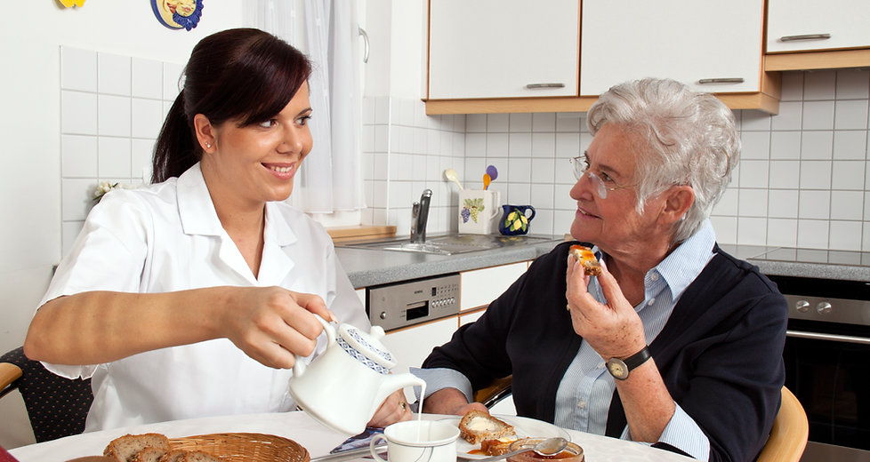A geriatric nurse helping senior at brea