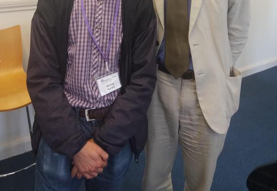 Our speaker, Professor Reiss, meeting an attendee (Ahmed Hamam).