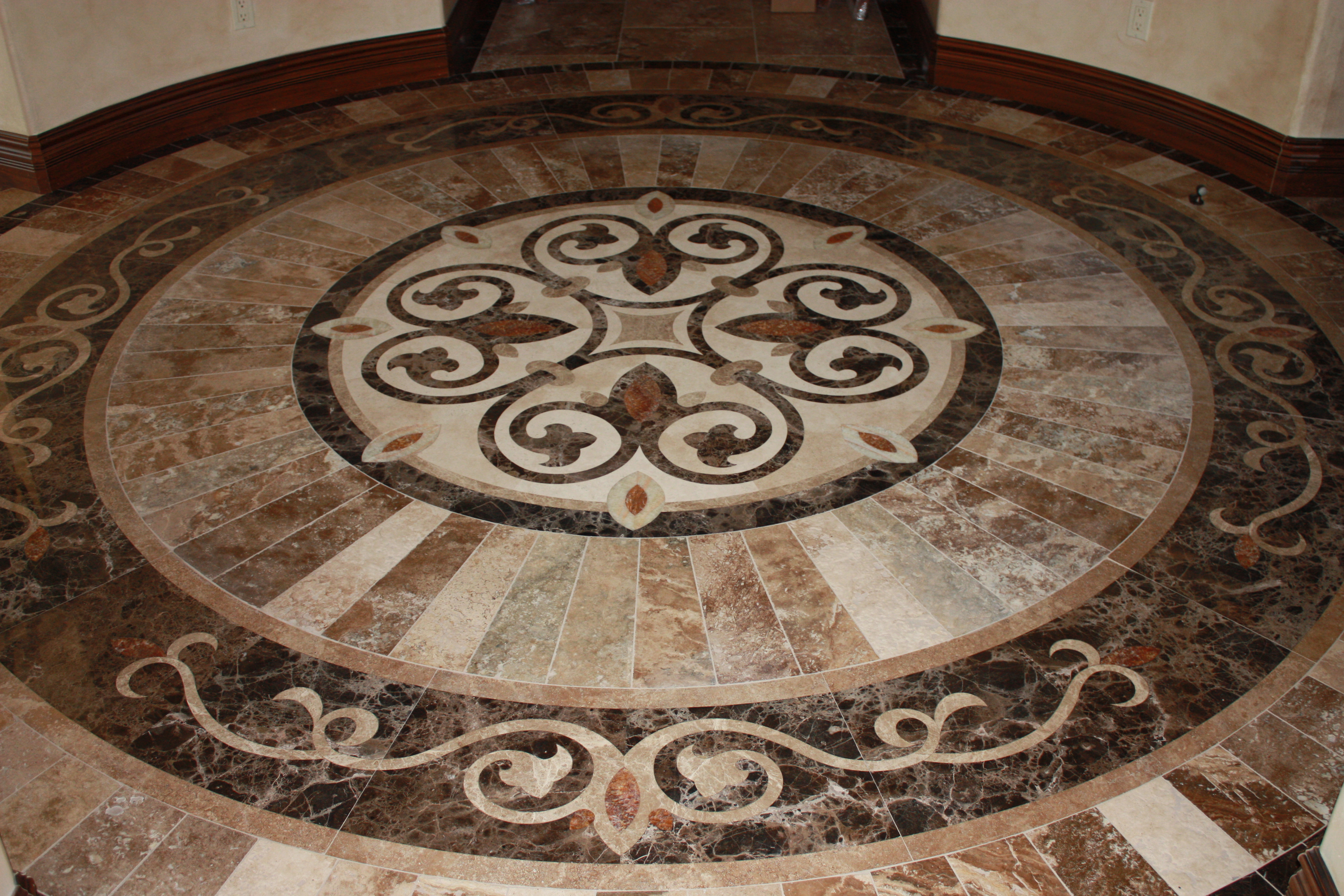 Stone-Floor-Waterjet-Inlay-Surrounded-by-Beautiful-Border
