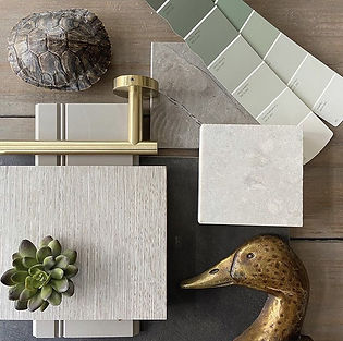 Cavalier and Company is an interior design, wedding and event planning firm, and experiential marketing team based in Chicago. This is a masculine mood board flat lay. This flatlay features brass hardware, stone, and custom cabinetry designs.