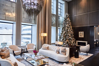 Cavalier and Company. Chicago holiday and christmas decor at the Ritz Carlton Residences. Design by Cavalier and Company features decorated Christmas tree with mixed metallic ornaments and lush ribbons. Cavalier and Co provides holiday decorating and design services for the hospitality industry, hotels, restaurants, corporate installations, holiday pop-up bars, and private homes and residences. Holiday and Christmas prop rentals and decor available.