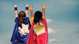 two children with star capes reaching for the stars