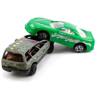 green toy car crashed on top of a grey toy car