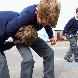 Boys fighting in the school playground