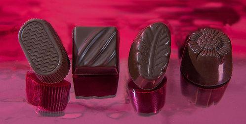 Bombón sin azúcar en chocolate negro y chocolate con leche