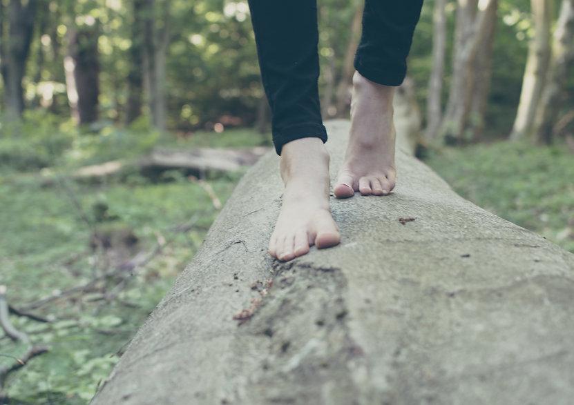 Feet walking on log