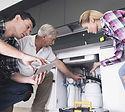 couple-talking-to-plumber-about-plumbing