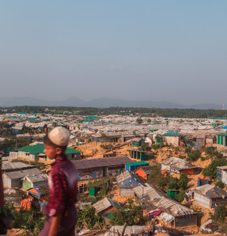 Two Rohingya boys on a hill in Kutupalong, now the largest refugee camp in the world. Before the 2017 exodus, there were already about 200,000 Rohingya who fled to Cox's Bazar years before and were living in the Kutupalong and Nayapara refugee settlements.  © RSG/Daniel Neo