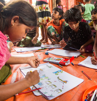 In a designated safe space for children in the Kutupalong extension site in Cox's Bazar, young Rohingya refugees were asked to draw their memories of fleeing their villages, as a therapeutic exercise.  © UNHCR/Roger Arnold