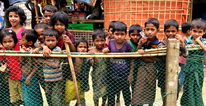 Curious Rohingya children hanging around in Kutupalong camp. There remains a severe lack of both formal and informal education in the camps, especially at the secondary level.  © RSG/Jonathan How