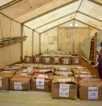 Staff at the UNHCR warehouse in Kutupalong inspect a delivery of reusable face masks donated by RSG, to be distributed to Rohingya children, youths and elderly who do not have masks.  © UNHCR/Md Arif Ahmed