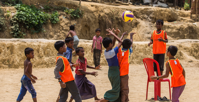 Young Rohingya boys having a game of Captain's Ball. Although they were more accustomed to soccer, the children were eager to learn a new sport.  ©RSG/Daniel Neo
